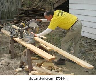Carpenter using a chop saw