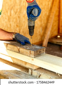 Carpenter using an electric screwdriver screwing wood screw into wood, Install and repair structures fixtures made from wood materials. Construction background
