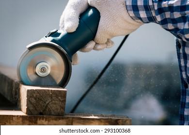 carpenter using saw tools electric cutting wood