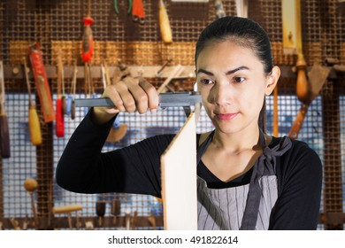 Carpenter using vernier caliper in workshop,women and tool,hand tool in woodworking