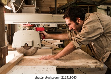 carpenter work with circular saw