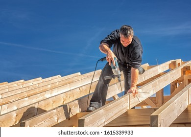 Carpenter at Work, Fixing a Rafter with a Long Screw