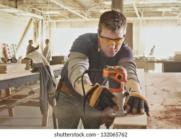 Carpenter at work at industrial job site