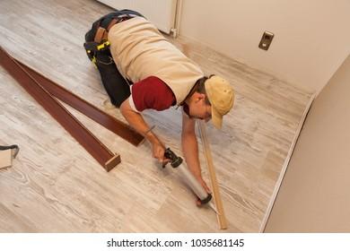 carpenter at work laying parquet floor