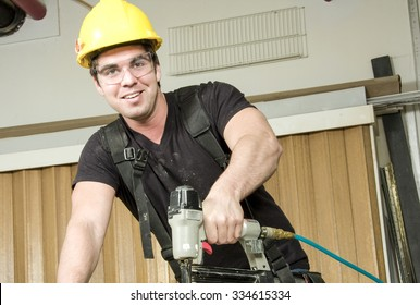 A Carpenter at work on job using power tool