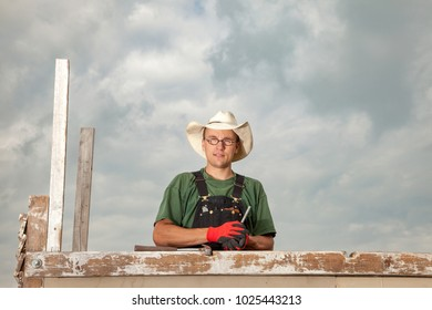 carpenter at work on a wooden construction