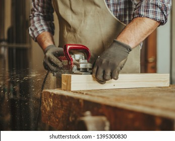carpenter at work with woodworking tools