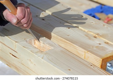 Carpenter working with chisel