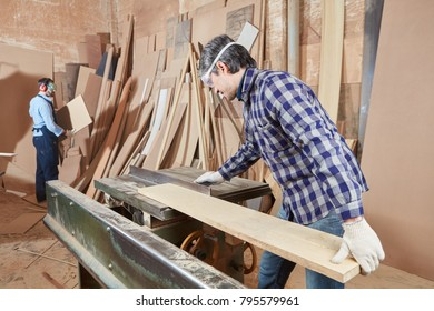 Carpenter working with circular saw in concentration