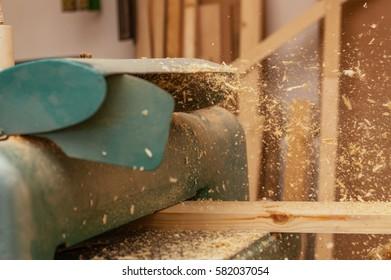 Carpenter working in a dusty workshop