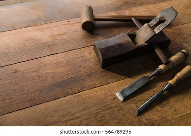 The carpenter was working furniture wood in studio , Soft-focus image