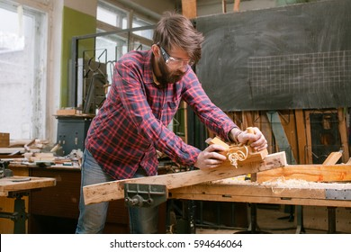 carpenter working with jack-plane