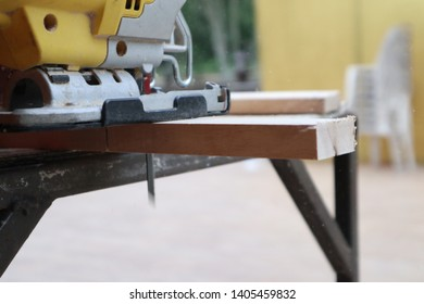 a carpenter working with jig saw and wood