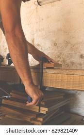 Carpenter working on raw wood.