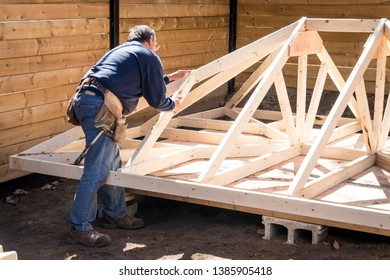 carpenter working on wood structure on residential construction