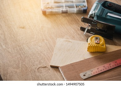 Carpenter working on woodworking machines in carpentry shop.The carpenter in workshop marks out the details of the furniture cabinet.