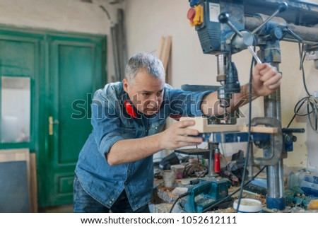 Carpenter Working On Woodworking Machines Carpentry Stock Photo
