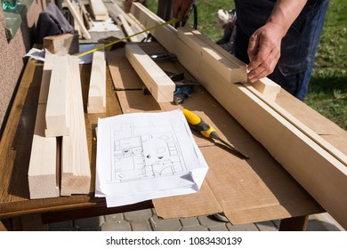 Men working construction images stock photos vectors shutterstock carpenter working with technical drawing or blueprint construction paper lying on a workshop outdoor desk malvernweather Images