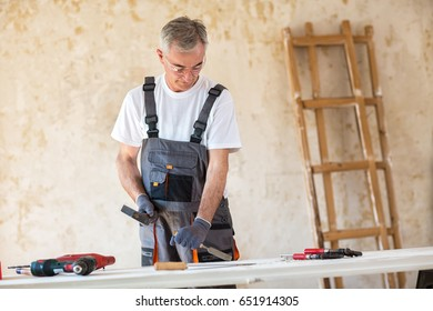 Carpenter is working in a workshop, close up