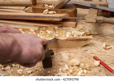 carpenter working,hammer,meter and screw-driver on construction background.