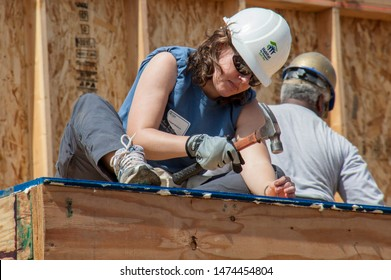 Carpenter works on building roof of new home for Habitat For Humanity charity on Jan 11, 2011