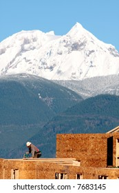 A carpenter works on a new development near Whistler, BC, site of the 2010 Olympic Games.