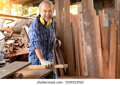 The carpenters experienced wood is using spokeshave to decorate the woodwork. for the furniture project.