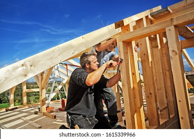Carpenters Setting up a Timber Roof Truss