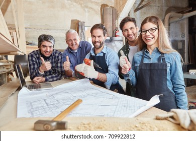 Carpenters team holding thumbs up for motivation