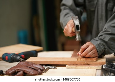 Carpenters uses a hammer to driving nail, Craftsmen and builder equipment