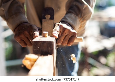The carpenters are using spokeshave to decorate the woodwork.