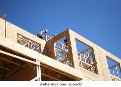 Carpenters working on wood frame condominium complex