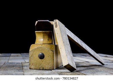 Carpentry is a hobby. Carpentry accessories on a wooden workshop table. Black background.