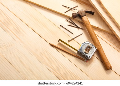 carpentry tools on wooden background, top view. Empty space for Your text