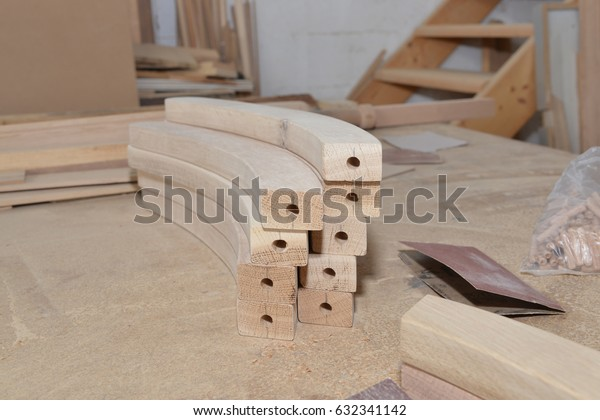 Carpentry workshop table and billets of wood for chair.