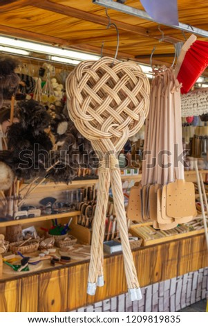 Carpet beater and flyswatter for sale at a market stall in Germany