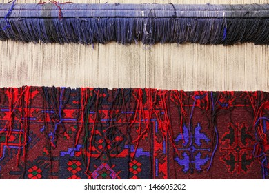Carpet loom with finished work closeup photo
