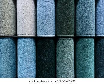 Carpet samples in a homeware store in cool tones