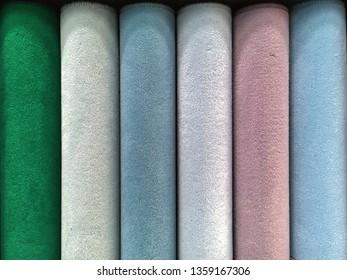 Carpet samples in a homeware store, in pastel hues