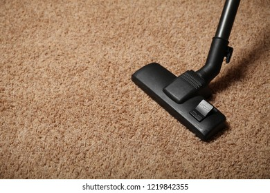 Carpet and vacuum cleaner. Apartment cleaning.