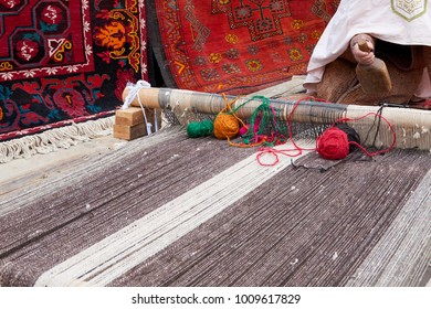 Carpet weaving. A carpet is a textile floor covering typically consisting of an upper layer of pile attached to a backing.