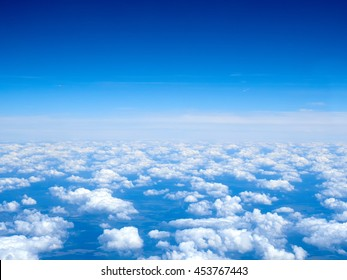 Carpet of white and fluffy clouds from above