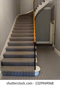 Carpeted staircase in a category B listed Georgian town house, painted in muted, neutral tones in Edinburgh, Scotland, UK