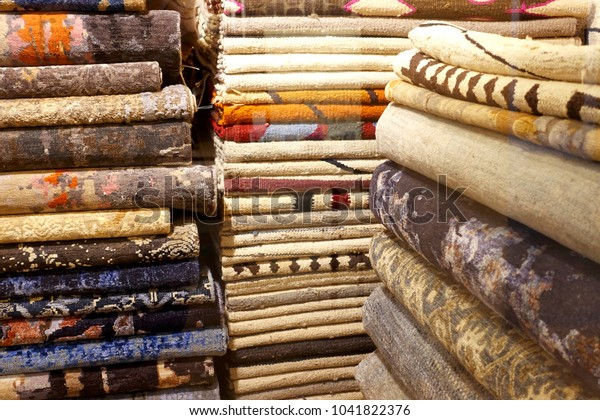 Carpets or fabrics are stacked in a store
