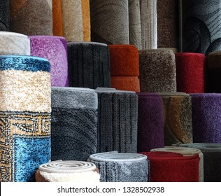 Carpets variety selection rolled up grey long rugs shop store