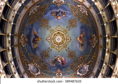 Carpi, Italy - November 19, 2011: adorned ceiling with a large crystal chandelier inside Municipal Theatre in Carpi, Italy.
