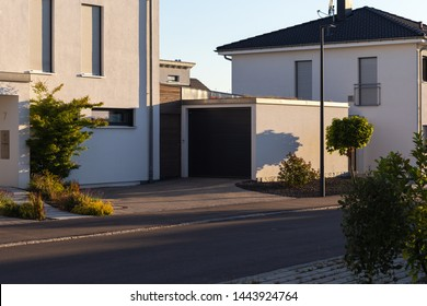 carport garage of entrace area modern houses at south germany summer evening