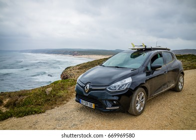 Carrapateira, Portugal - Circa June 2017 - Surf board on a rental car