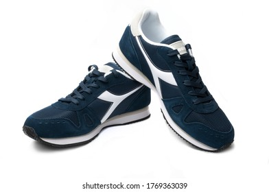 """Carrara, Italy - July 3, 2020 - A pair of blue Diadora """"Simple Run"""" shoe isolated on white background"""