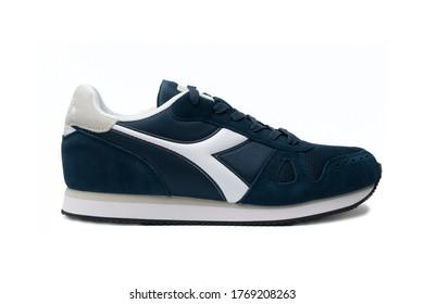 "Carrara, Italy - July 4, 2020 - Diadora ""Simple Run"" blue shoe isolated on white background"